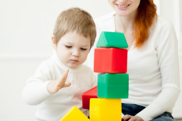 baby-playing-with-colorful-toy-blocks